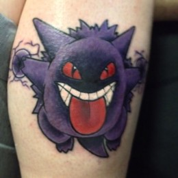 "Tattoo of Pokemon character ""Gengar"" on a man's calf"
