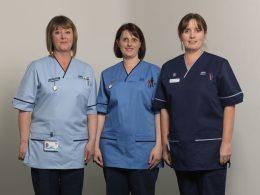 Three nurses stood side by side