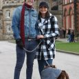 Couple pose for picture with their dog